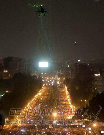 Egyptians within protesting crowd of millions use lasers to blind helicopter pilot